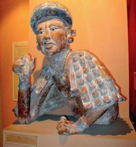 Mayan nobleman offering cocoa paste. Image courtesy of Yelkrokoyade,