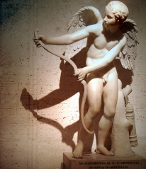 Cupid, Roman god of love, stringing his bow; Roman copy after Greek original by Lysippos. Musei Capitolini, Rome.